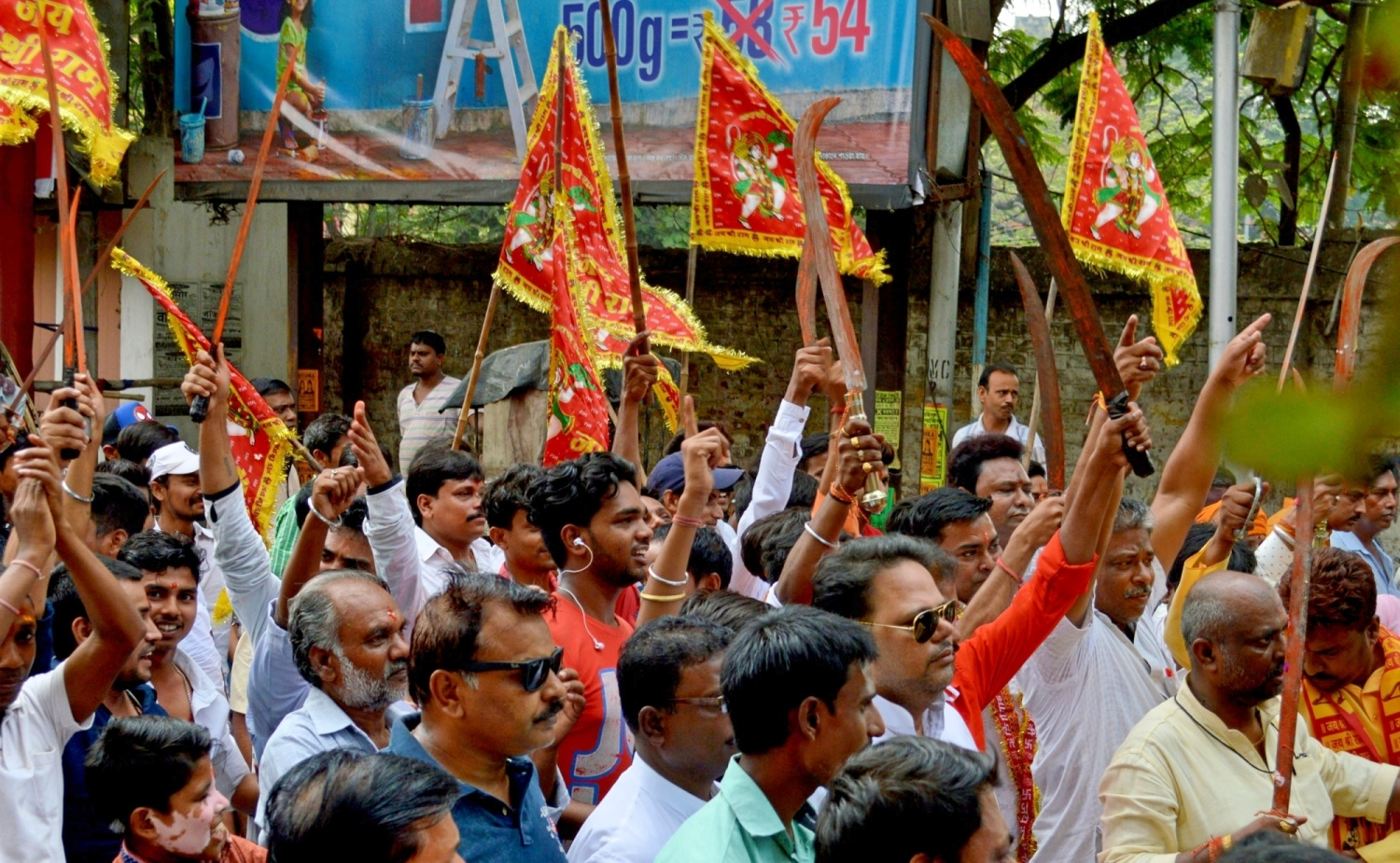 Members of the Kshatriya Samaj wave swords as they participate in a rally on Ram Navami in Howrah, West Bengal, on March 25.  (Photo credit: IANS).