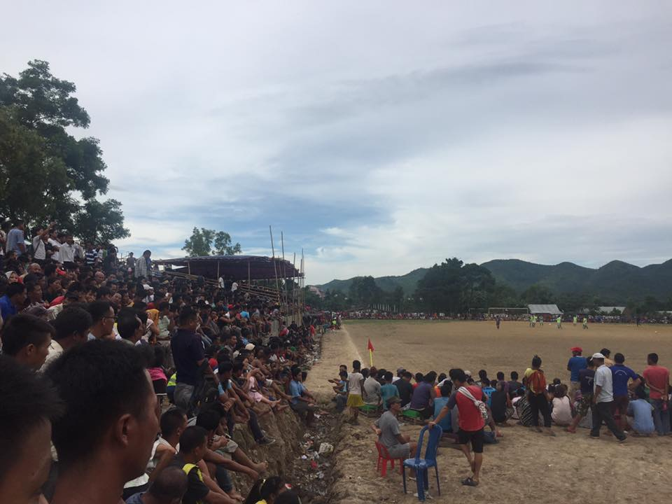 A group of spectators watches a district match in Churachandpur. (Image courtesy: Junior Zemz)