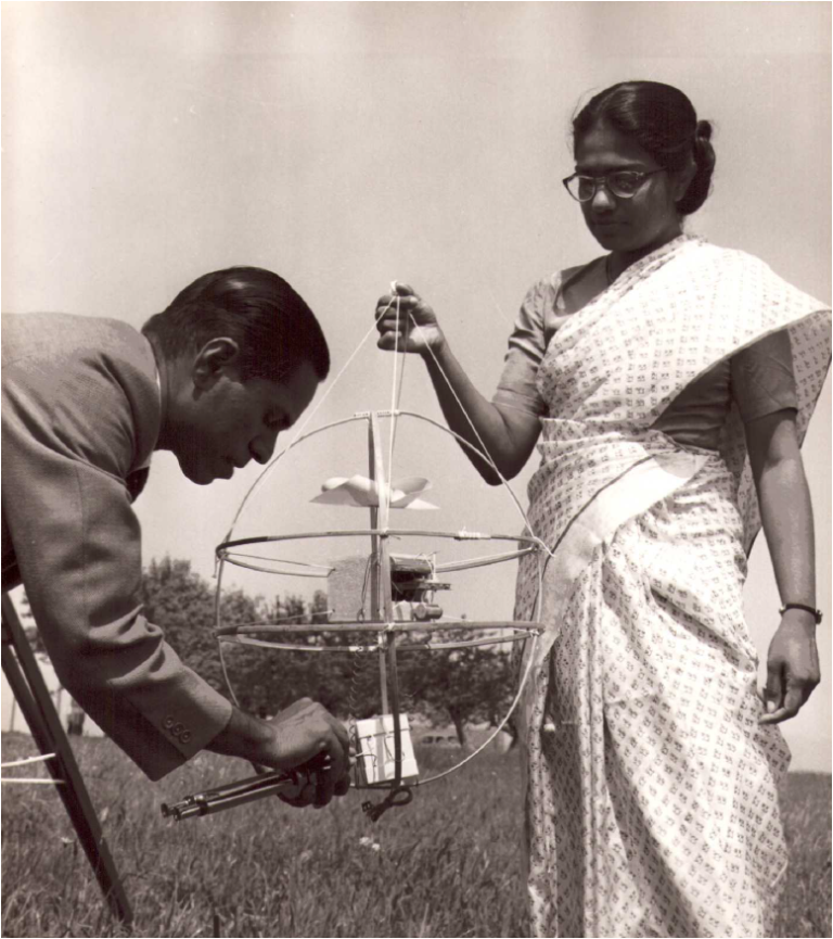 Mani and a colleague work on a radiosonde, a balloon-borne weather-measuring equipment. Photo credit: World Meteorological Organization.
