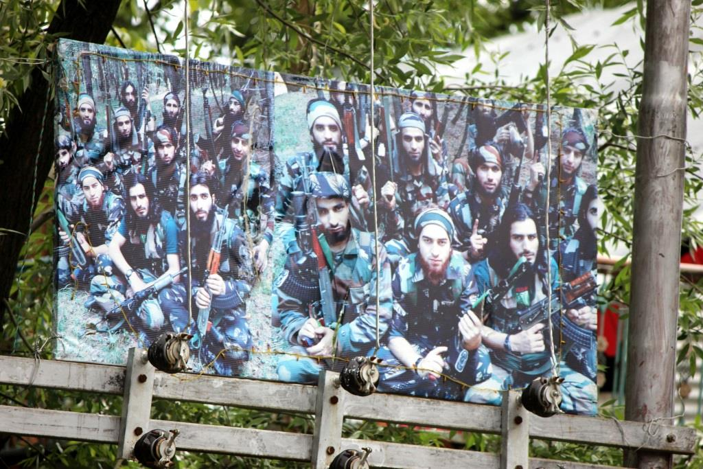 Poster of militants outside Abdul Gani Dar's house. Picture credit: Muneeb ul Islam