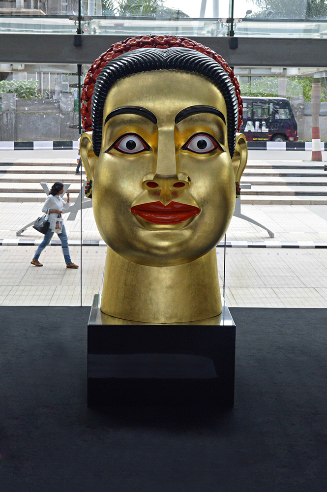 Ravinder Reddy's head sculptures have become some of his most iconic pieces. 'Devi', with her unwavering gaze, protruding lips and golden skin, is a quintessential example of his work.