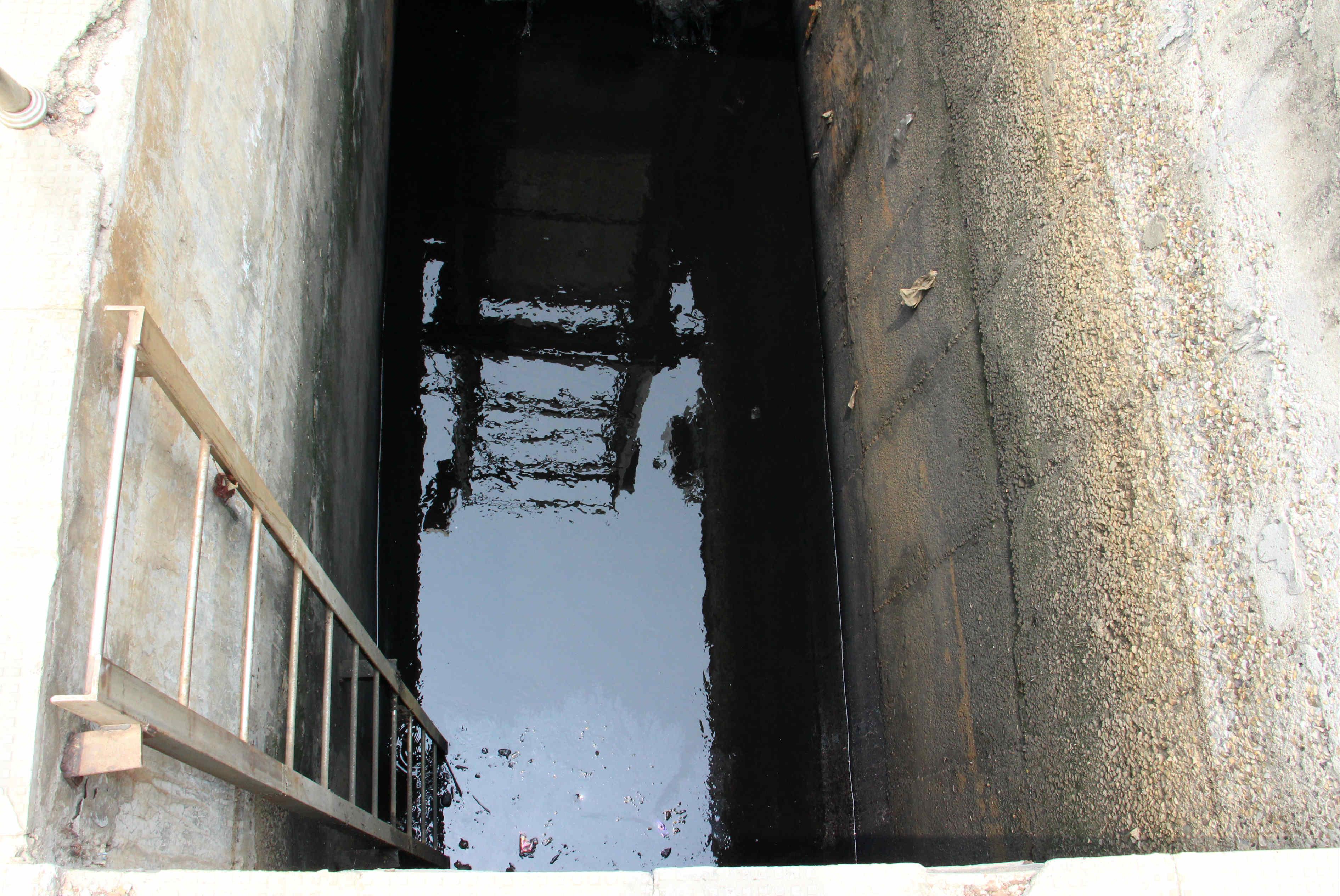 The sewage tank where the three men choked to death. Photo credit: Aabid Shafi