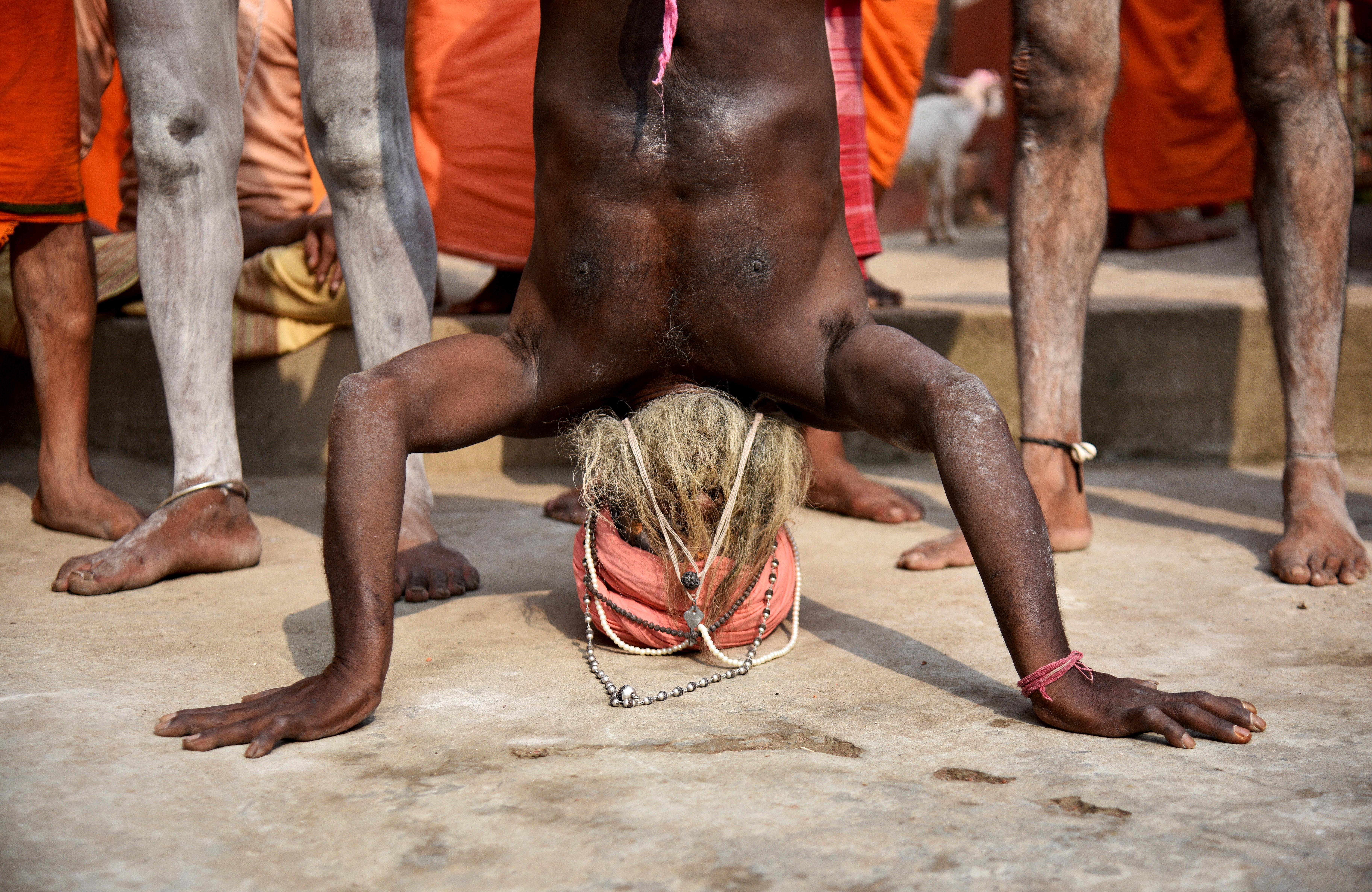 A religious leader performs yoga on International Yoga Day at Kamakhya temple in Guwahati. (Anuwar Hazarika/Reuters)