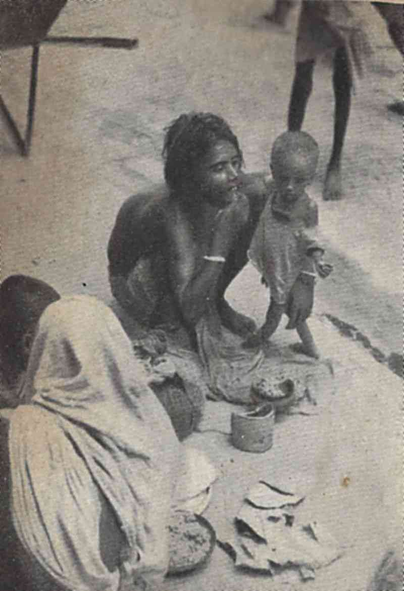 A destitute mother and child on the sidewalk in Calcutta during the Bengal famine of 1943-44. Courtesy Kalyani Bhattacharyee, and Sj. Manoj Sarbadhikar/Wikimedia Commons.