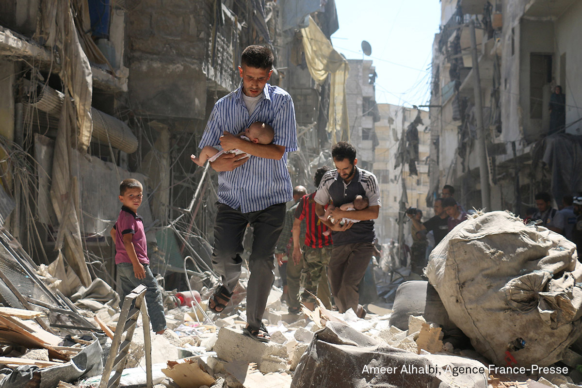 Spot News, second prize (stories) | Rescued from the Rubble: Syrian men carrying babies make their way through the rubble of destroyed buildings following a reported airstrike on the rebel-held Salihin neighborhood of Aleppo. Airstrikes have killed dozens in rebel-held parts of Syria as the opposition considers whether to join a US-Russia truce deal due to take effect on September 12. (Ameer Alhalbi for Agence France-Presse)