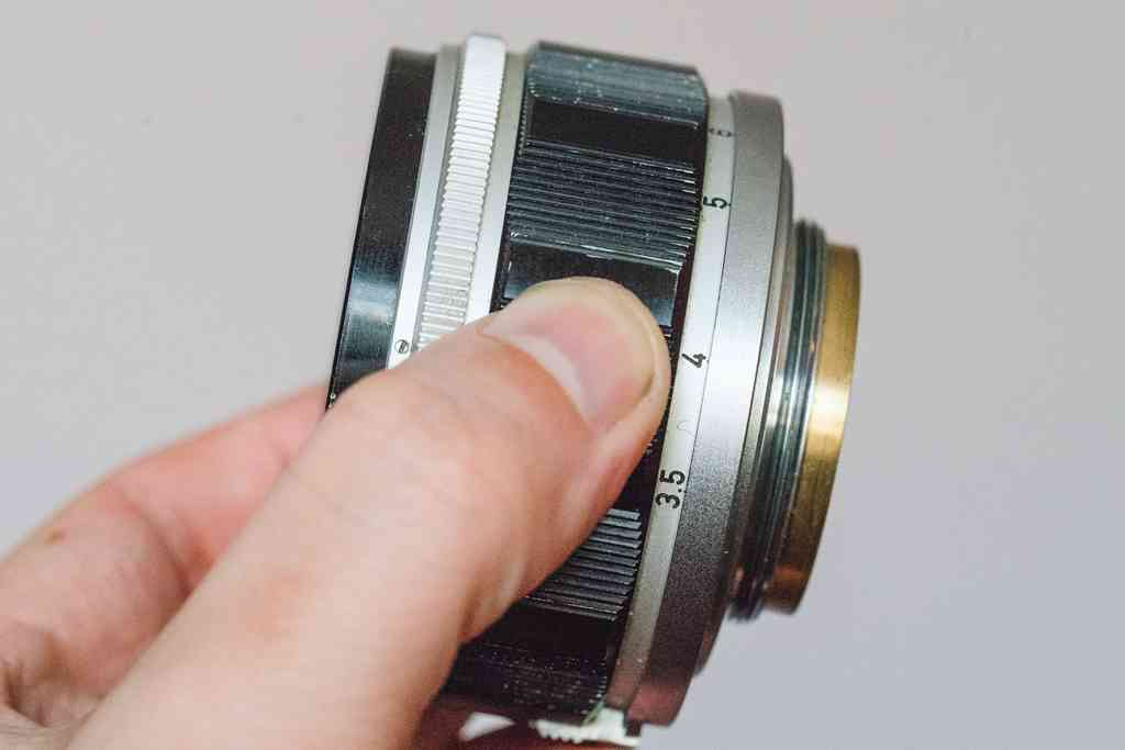 This Canon 50mm f/1.2 lens was made to mount on rangefinder cameras with Leica's L39 screwmount instead of a modern bayonet. The screw threads are visible on the right side of the lens in this image. Photo credit: Phil Ryan.