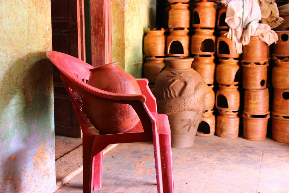 The house is stacked high with terracotta; only the ghatam is seated on a plastic chair.