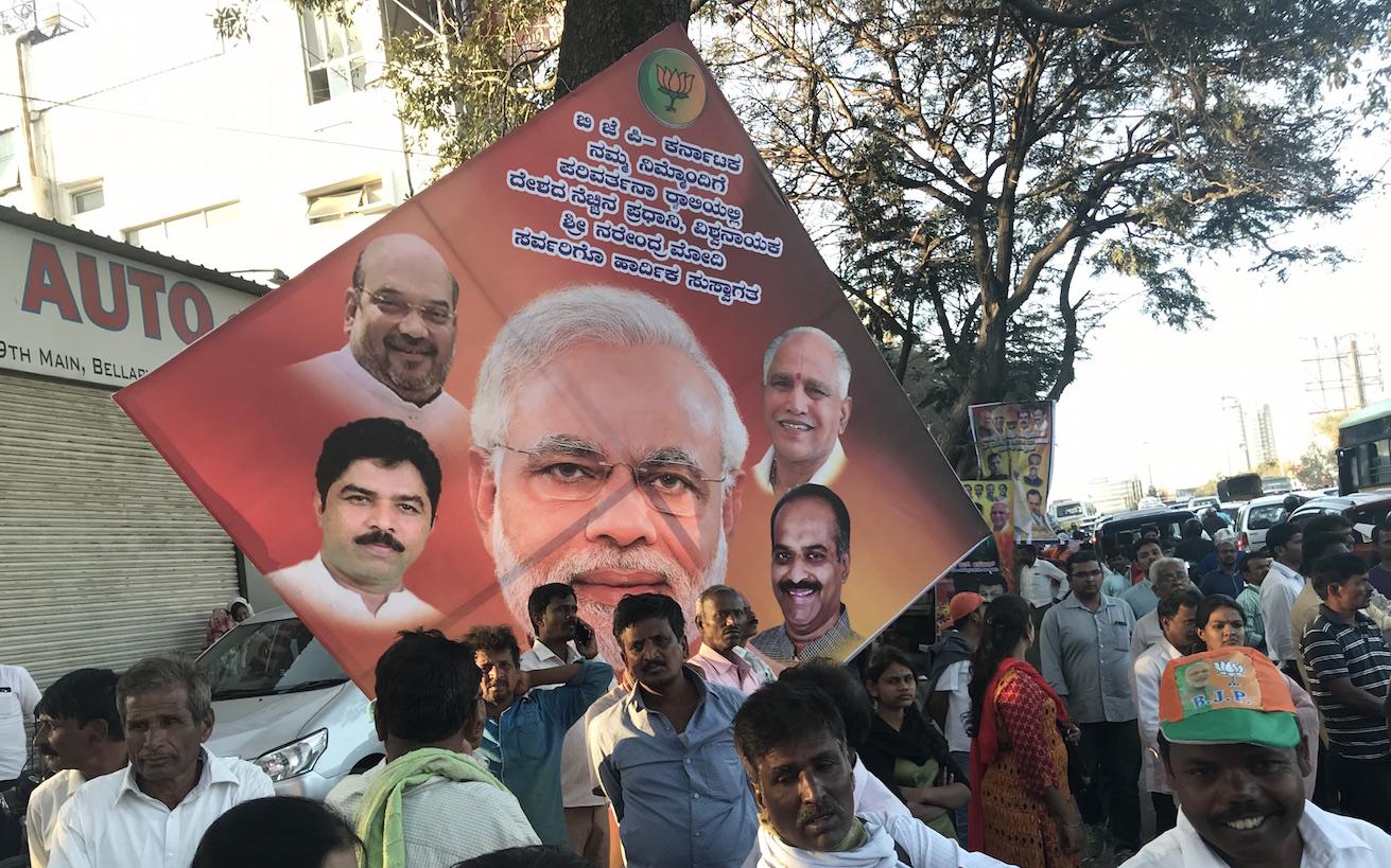 Prime Minister Narendra Modi dominates the BJP's election posters in Karnataka.