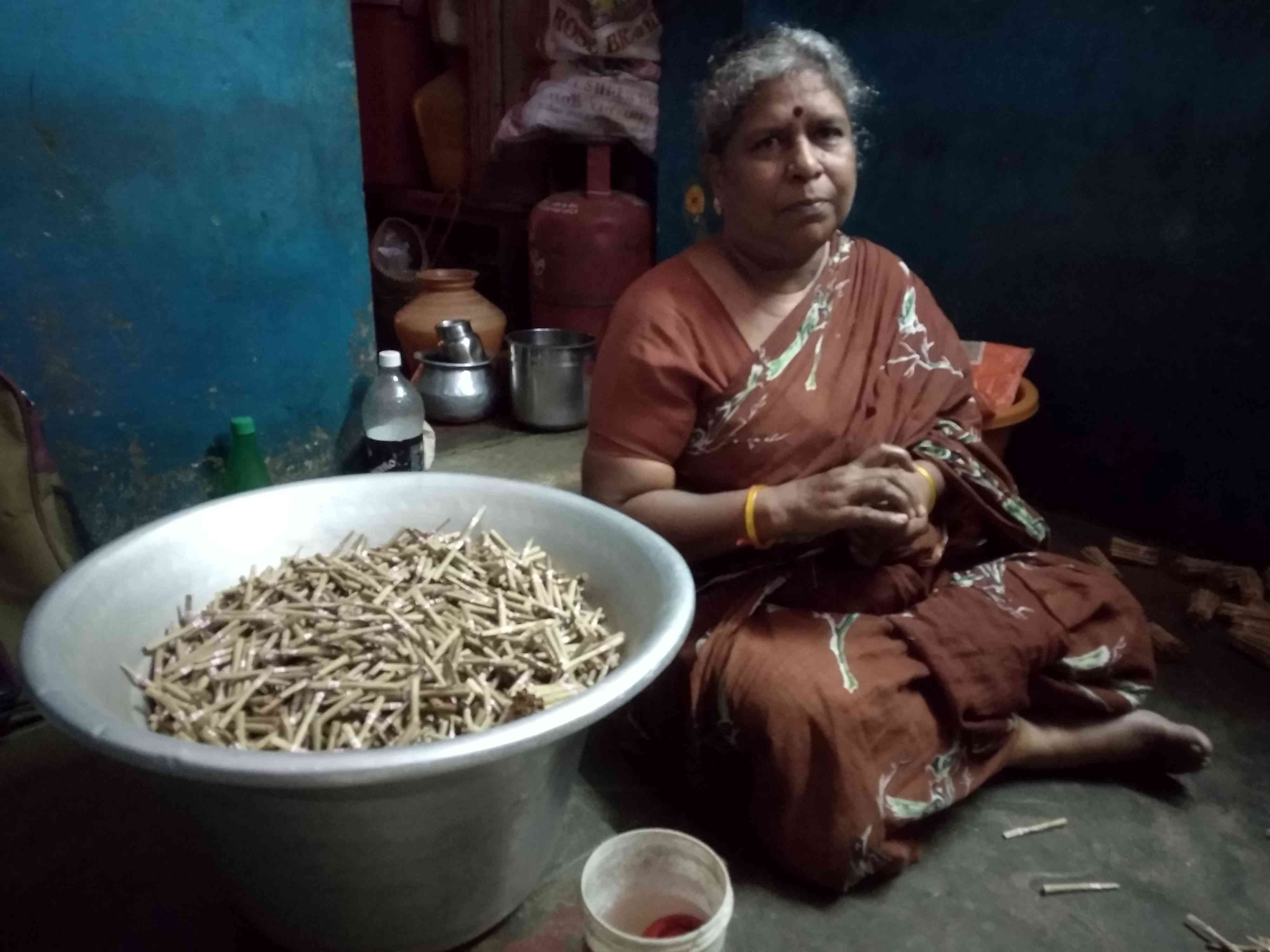 A Madhavi stick labels and bundles beedis at her home in Kaspa in Vellore in Tamil Nadu. Photo credit: S Senthalir
