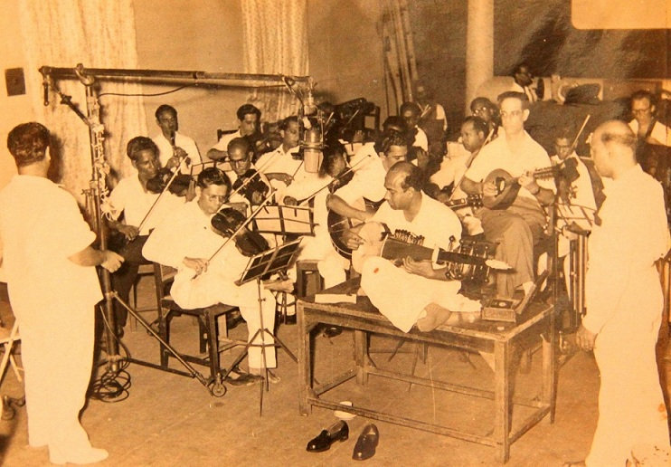 Harishchandra Narvekar (front row) with sarod maestro Ali Akbar and other musicians recording a background score at Famous Studio. Courtesy Shrinivas Narvekar.