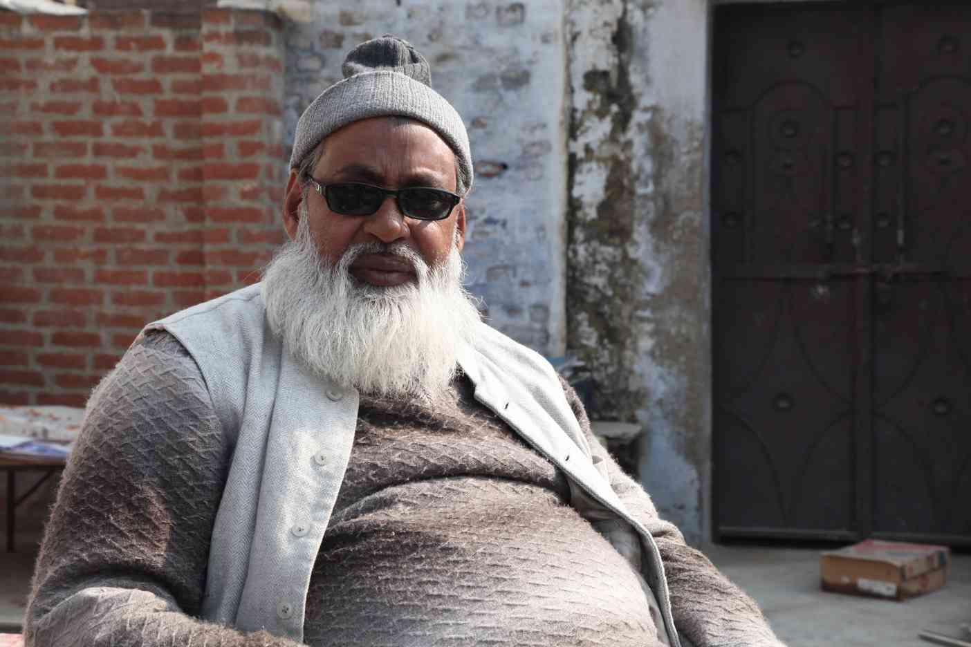 Zarar Ahmad, the president of the association of village chiefs, believes the government is discriminating against Muslim villages.