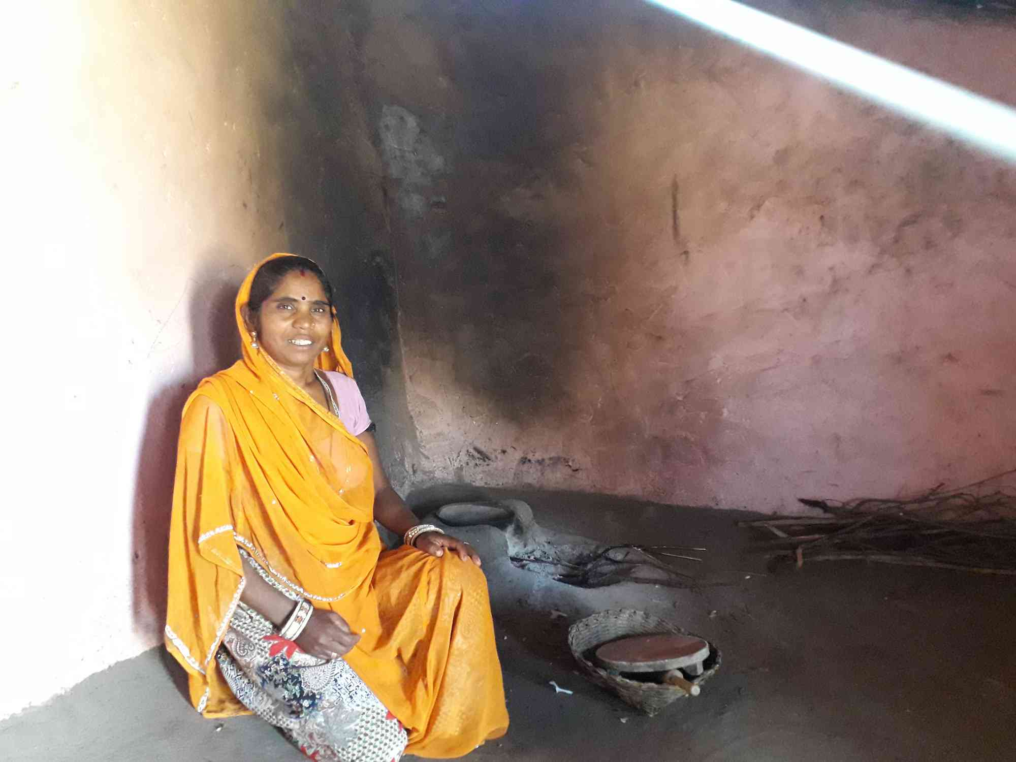 Kalubai Bargot cooks on an indoor firewood stove because refilling her LPG gas cylinder is too expensive.