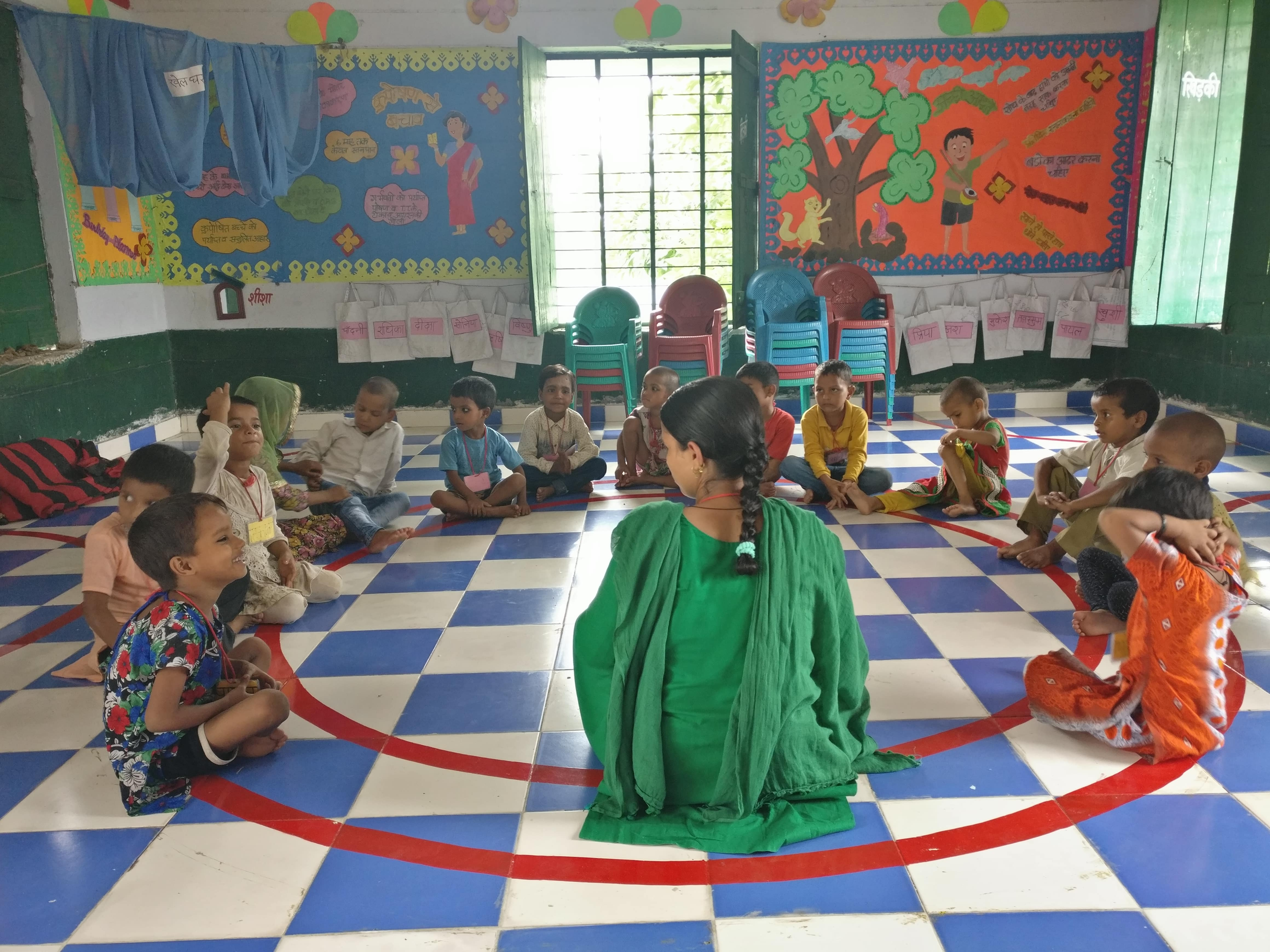Children sit in a circle to improve their engagement skills. Photo credit: Shreya Roy Chowdhury