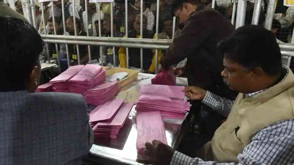 Election Commission officials count postal ballots at Bhopal old jail counting centre. (Mujeeb Faruqui/HT Photo)