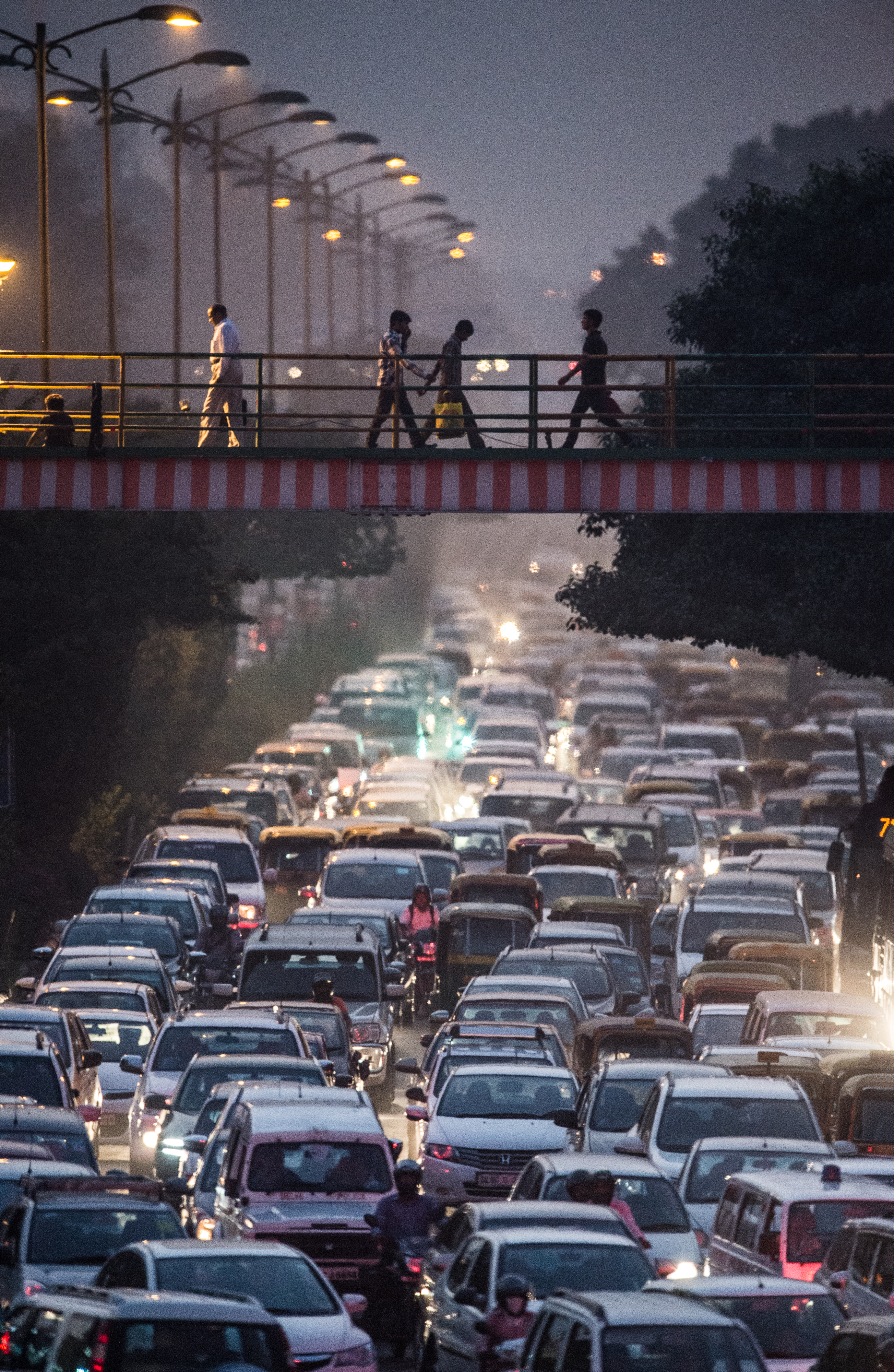 Improving air quality requires sacrifices. But how many are willing to ditch their diesel cars and take the bus or Metro? (Roberto Schmidt / AFP)