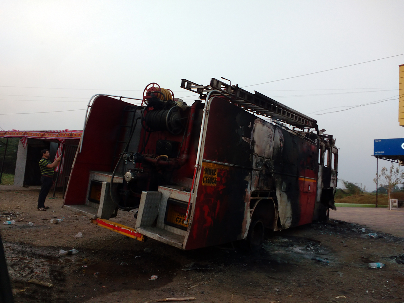 A burnt fire engine at Sanaswadi, just north of Koregaon Bhima. Photo: Mridula Chari