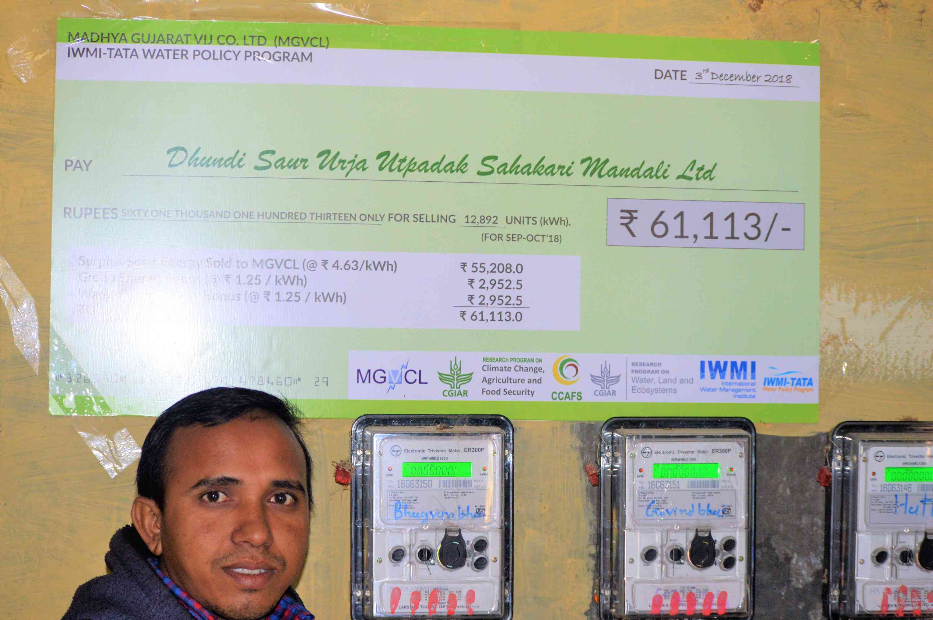 A farmer at the central evacuation point in Dhundi farmers each have their own energy meter installed to keep count of energy being sold to MGVCL. Photo Credit: Athar Parvaiz