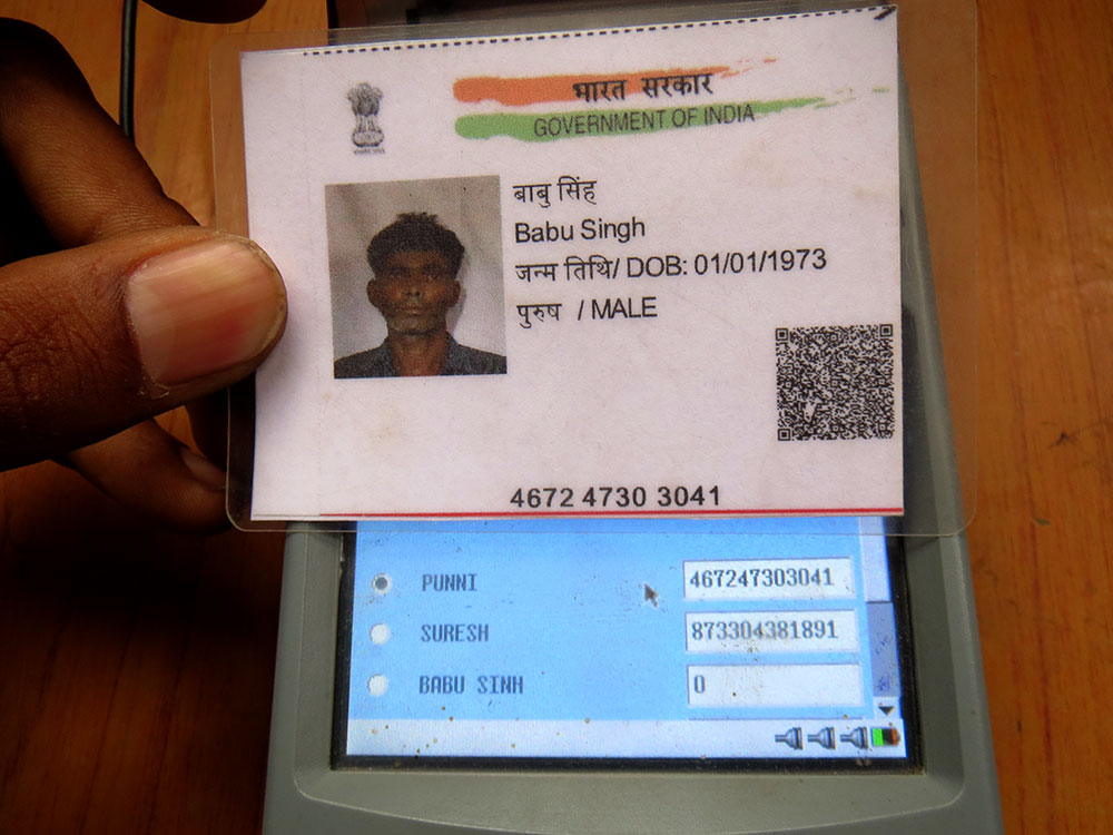 The machine reads the Aadhaar number on construction worker Babu Singh's Aadhaar card as belonging to his spouse Punni Devi.