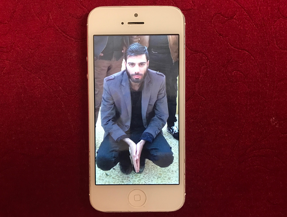 Mosab, 23, was killed in a strike in January. His picture, as seen on his sister's phone.