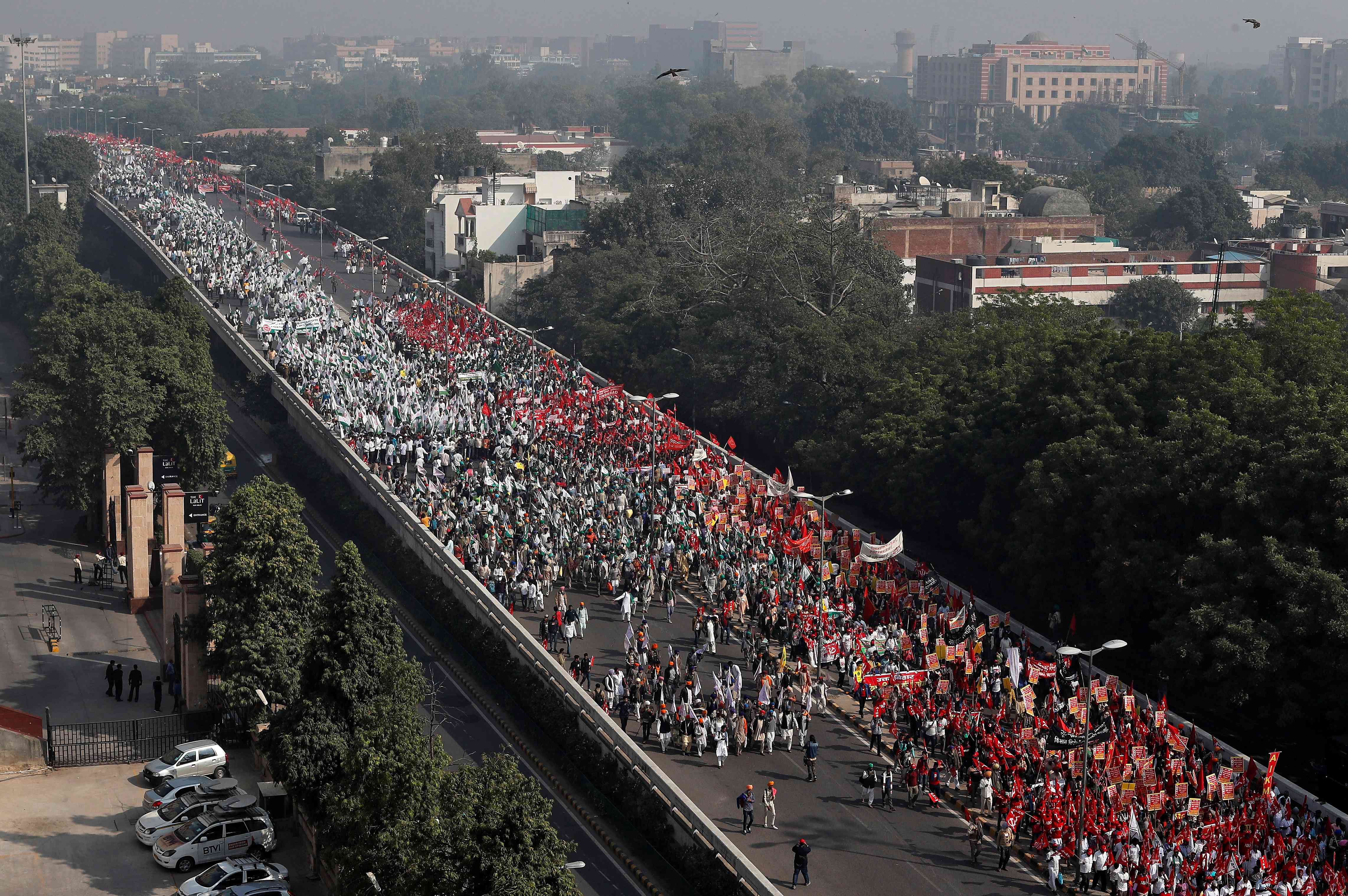 Farmers march towards Parliament House in New Delhi on Friday. (Photo credit: Adnan Abidi/Reuters).