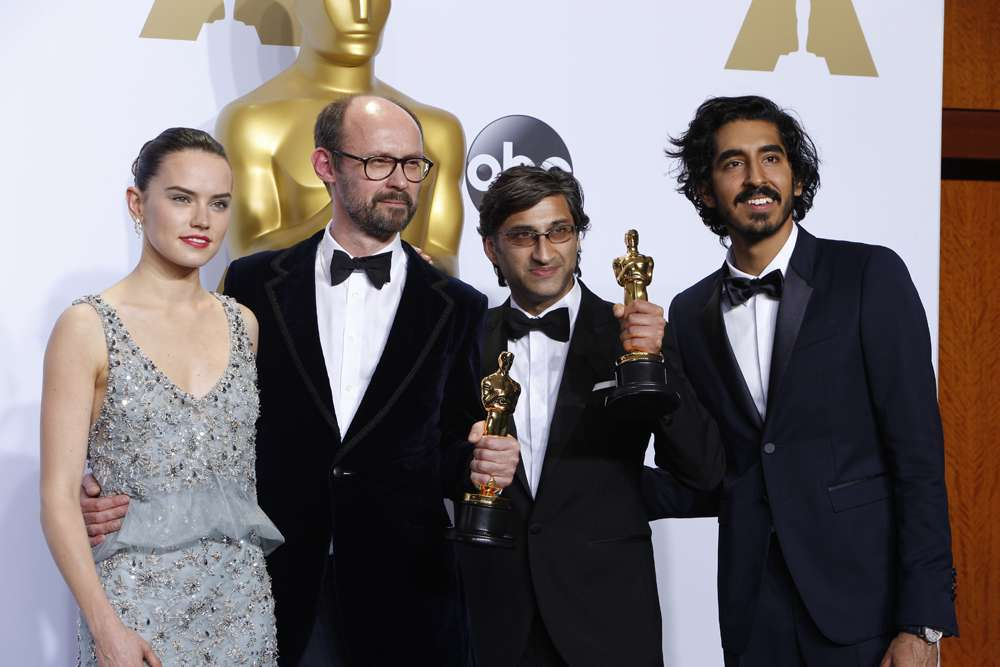 Presenters Daisy Ridley and Dev Patel pose with 'Amy' director Asif Kapadia (second from right).