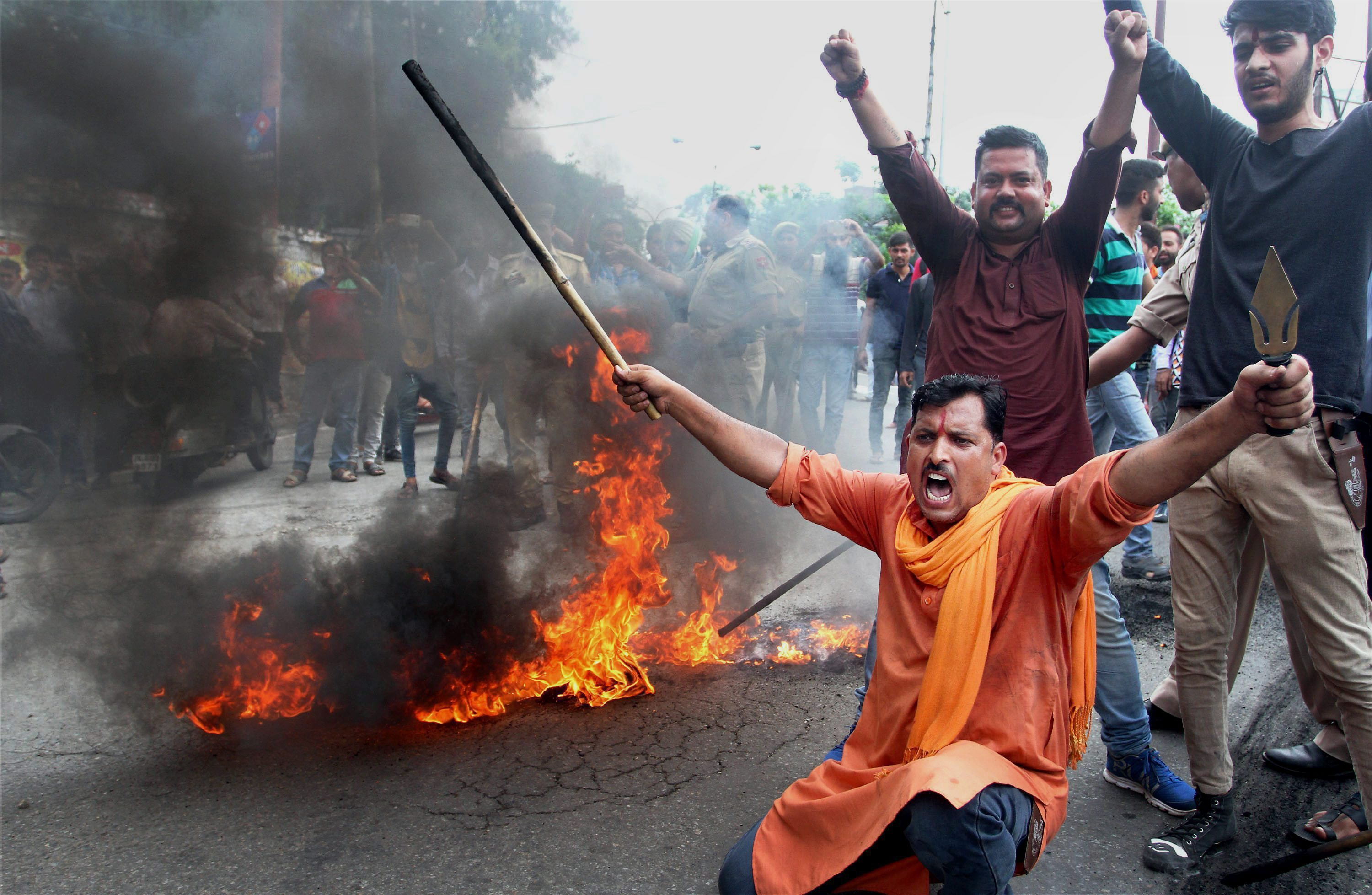 Bajrang Dal activists burn tyres and block a road in Jammu after a bandh was called in response to the Amarnath attack. (Credit: PTI)