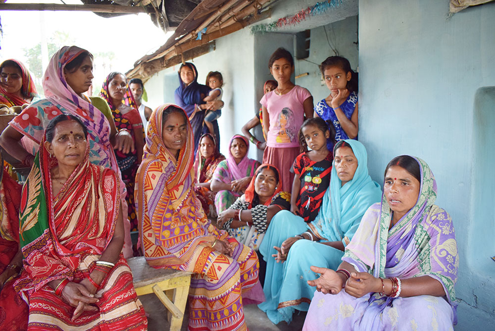 Women in the village of Ranganiya say they were not allowed inside the social impact assessment hearing in the village of Buxara.