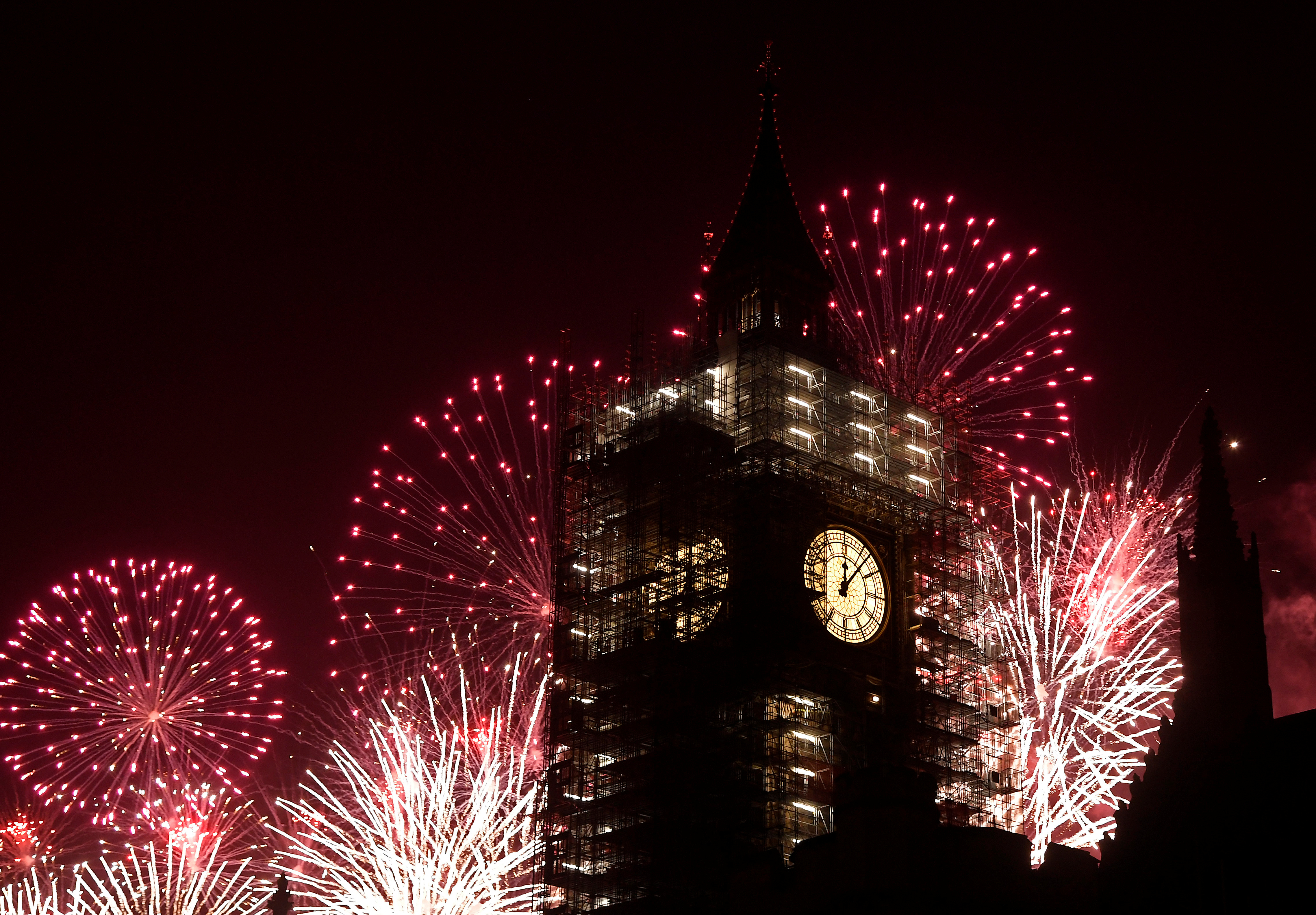Fireworks explode behind Big Ben during New Year's Eve celebrations in London, Britain. (Image credit: Toby Melville/Reuters)