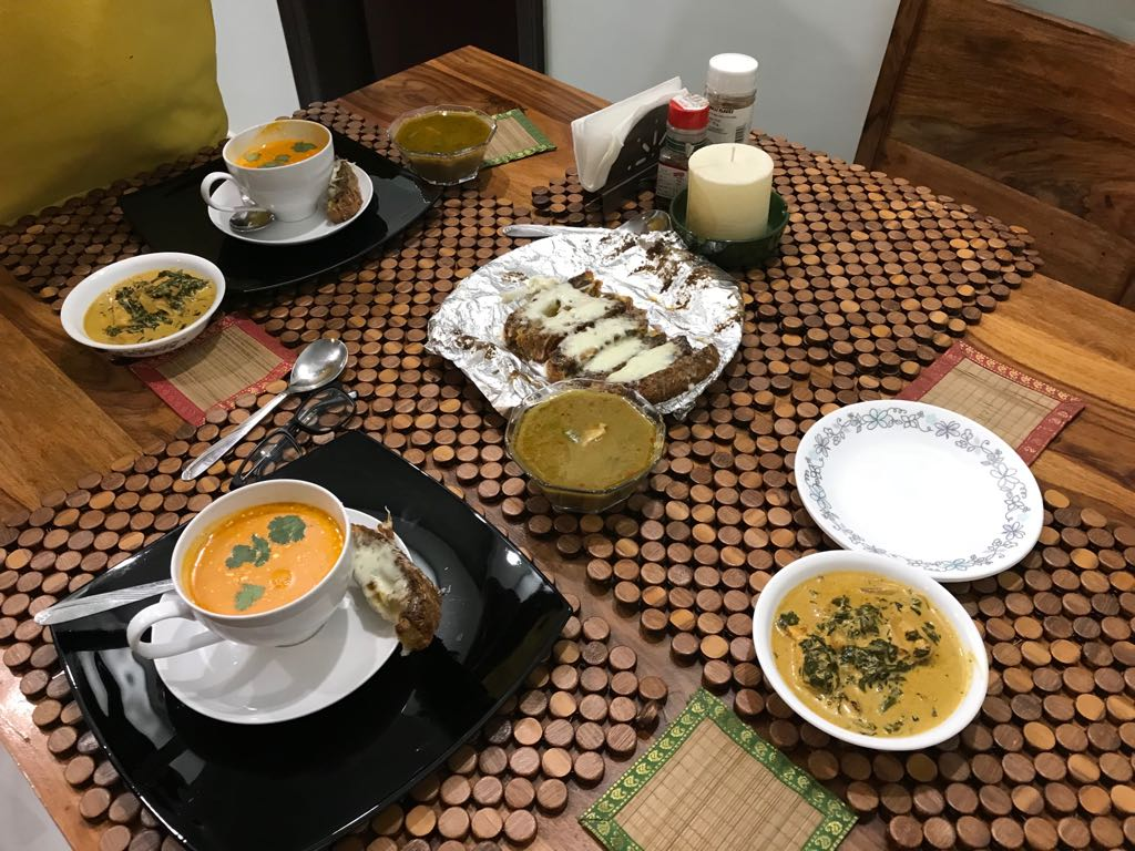 Rajesh Dudeja makes a low-carbohydrate high-fat meal for two, consisting of creamy tomato soup, methi paneer, chicken curry and carbohydrate-free garlic bread made from almond flour. Photo credit: Archana Yadav
