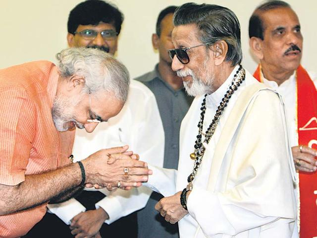 In this file picture from 2002, Shiv Sena chief Bal Thackeray, who played a key role in the Mumbai riots, greets Narendra Modi, who was then chief minister of Gujarat.