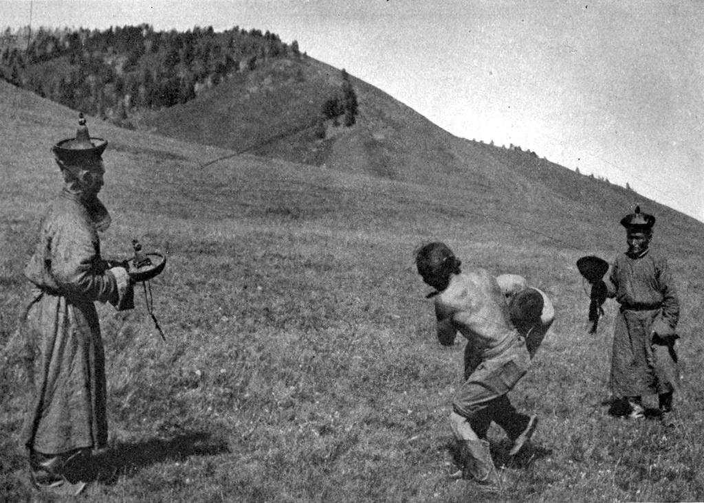 """Wrestlers at Terelche Valley Field Meet"", featured in Across Mongolian Plains (1921)."