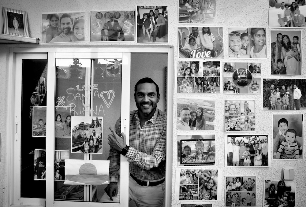 "Kamal Parwani's office is interesting – every inch of the wall is pasted with family photographs – mainly of his two daughters. He says, ""That's my CV, that's my encyclopedia"". He got into business at the age of 17 as he didn't want to waste time on education. Now, 37-year-old Kamal runs a 5,000 square metre warehouse, trading in over 7000 items every day. Photo: Kounteya Sinha/Spain"