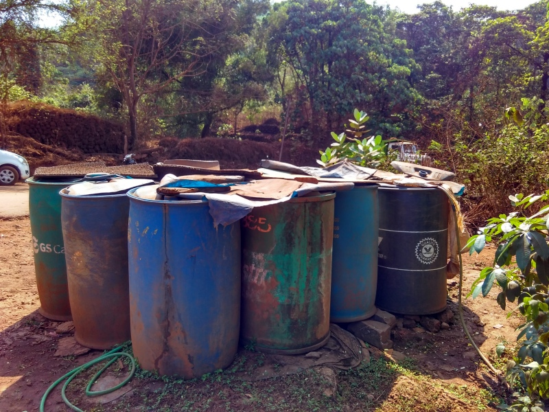 Drums to collect tanker water at Sonshi village. (Photo credit: Pamela D'Mello).