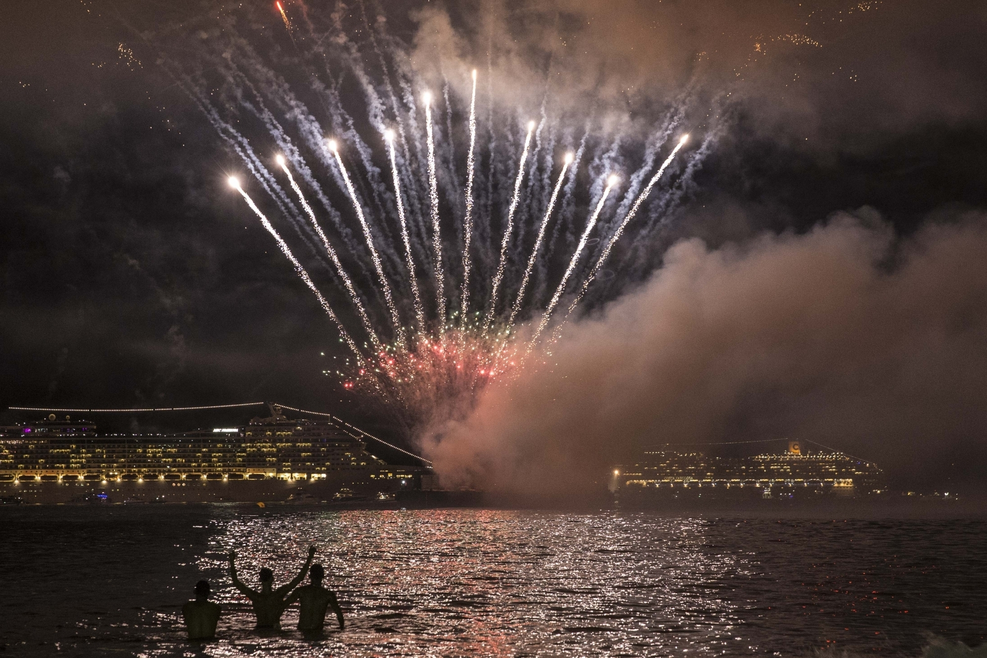 People watch fireworks celebrating the New Year in Rio De Janeiro, Brazil. (Image Credit: Xinhua/IANS)