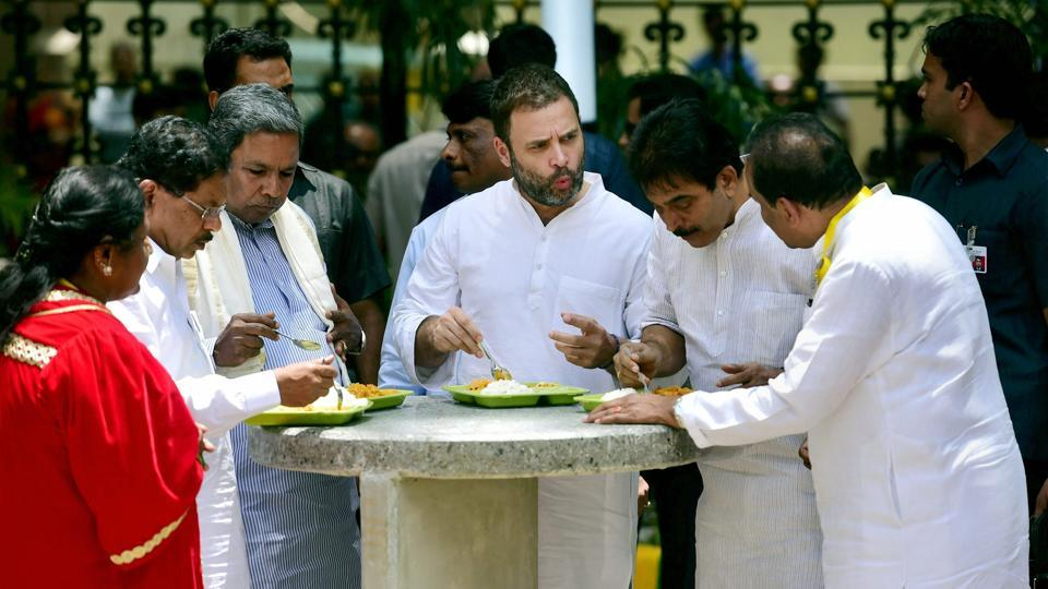 Congress vice president Rahul Gandhi with Karnataka chief minister Siddaramaiah and others at an Indira Canteen in Bengaluru. Credit: PTI