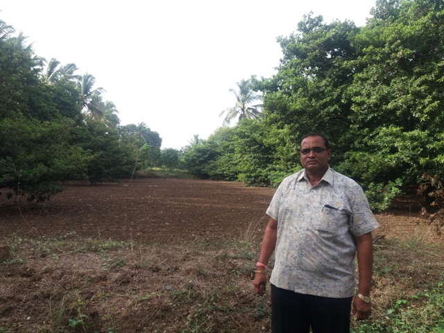 Farmer Mahesh Patel lost 130 fruit trees when an underground gas pipeline was laid across his farm. (Photo credit: Aarefa Johari)