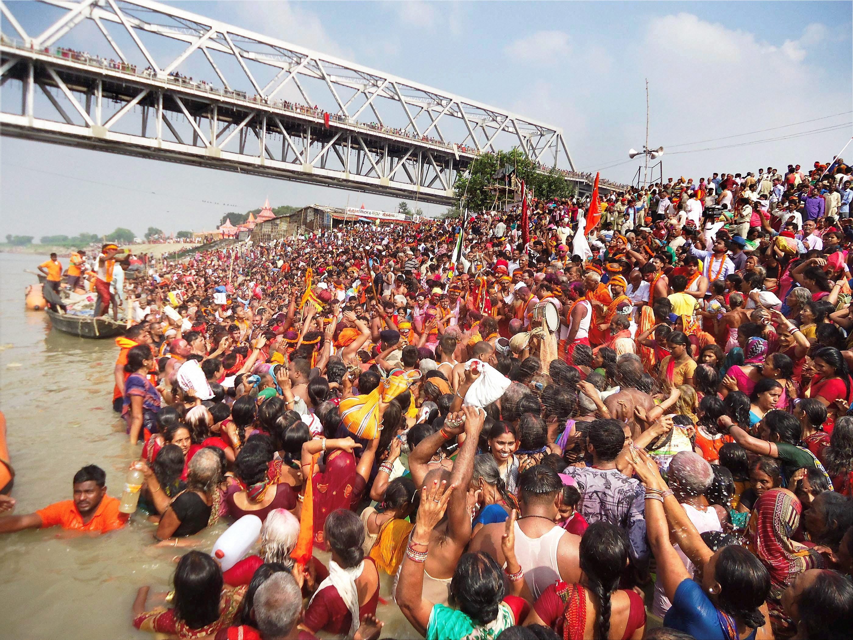 Devotees take a holy dip in the Ganga in Bihar's Simariya Ghat in Begusarai. (Credit: PTI)