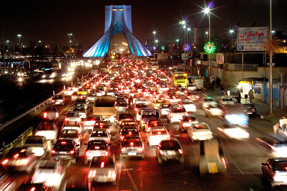 "There is heavy traffic almost any time of day in Iran's big cities. Here, vehicles are heading towards the Azadi Tower (in background) in Tehran. Built in 1971 in commemoration of the 2,500th anniversary of the Persian Empire, this ""gateway into Tehran"" was named the ""Shahyad"" (King's Memorial) in honor of the Shah, but was changed to ""Azadi"" (Freedom) after the Revolution of 1979."