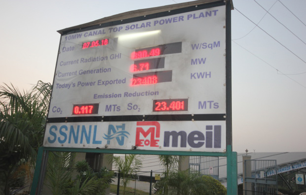 A board outside the 10 MW canal-top solar plant in Vadodara shows the daily export of power from the plant as well reduction in emissions. Image Credit: Mukta Patil / IndiaSpend