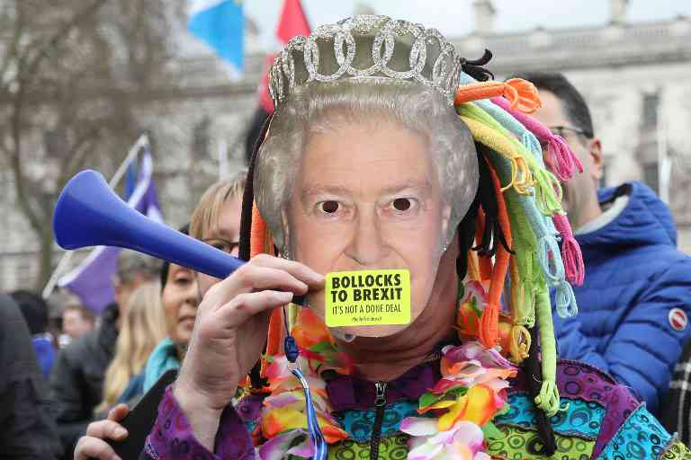 A protester wears a mask of the Queen at a rally organised by the pro-European People's Vote campaign for a second EU referendum in Parliament Square, central London on March 23, 2019. Image credit: Isabel Infantes / AFP
