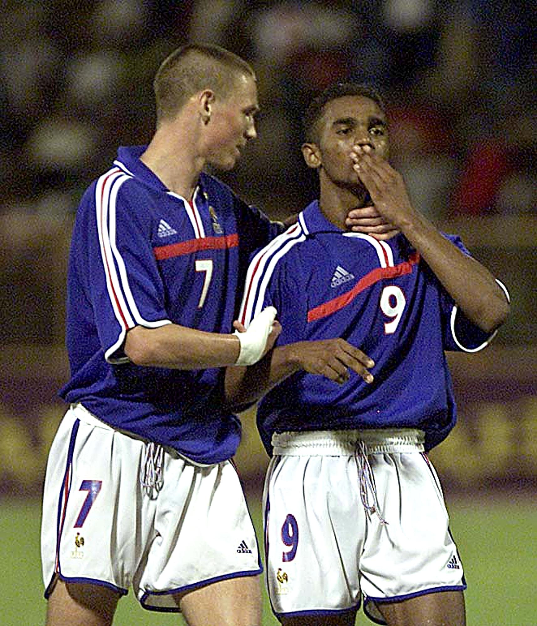 Florent Sinama Pongolle (right) celebrates a goal for France with cousin Anthony Le Tallec (Image: AFP)