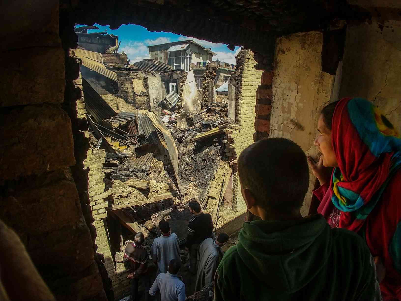 The rubble of houses destroyed during a gunfight in Khudwani. Photo credit: Rayan Naqash