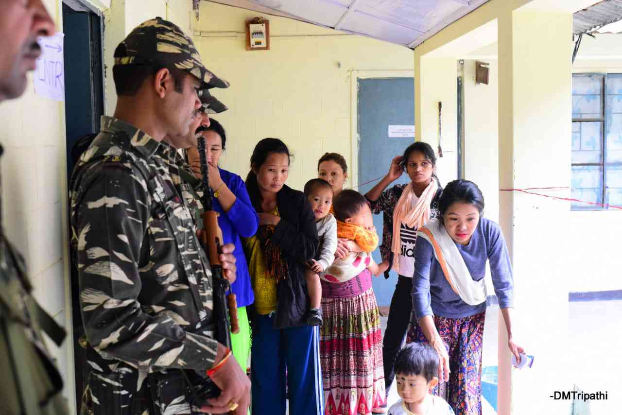 Soldiers from Deepak Mani Tripathi's battalion at a polling station in Seppa, Arunachal Pradesh. The security staff 'can peep in but not enter' the booth. On the election trail, Tripathi either took photos himself or members of his team did with his camera.
