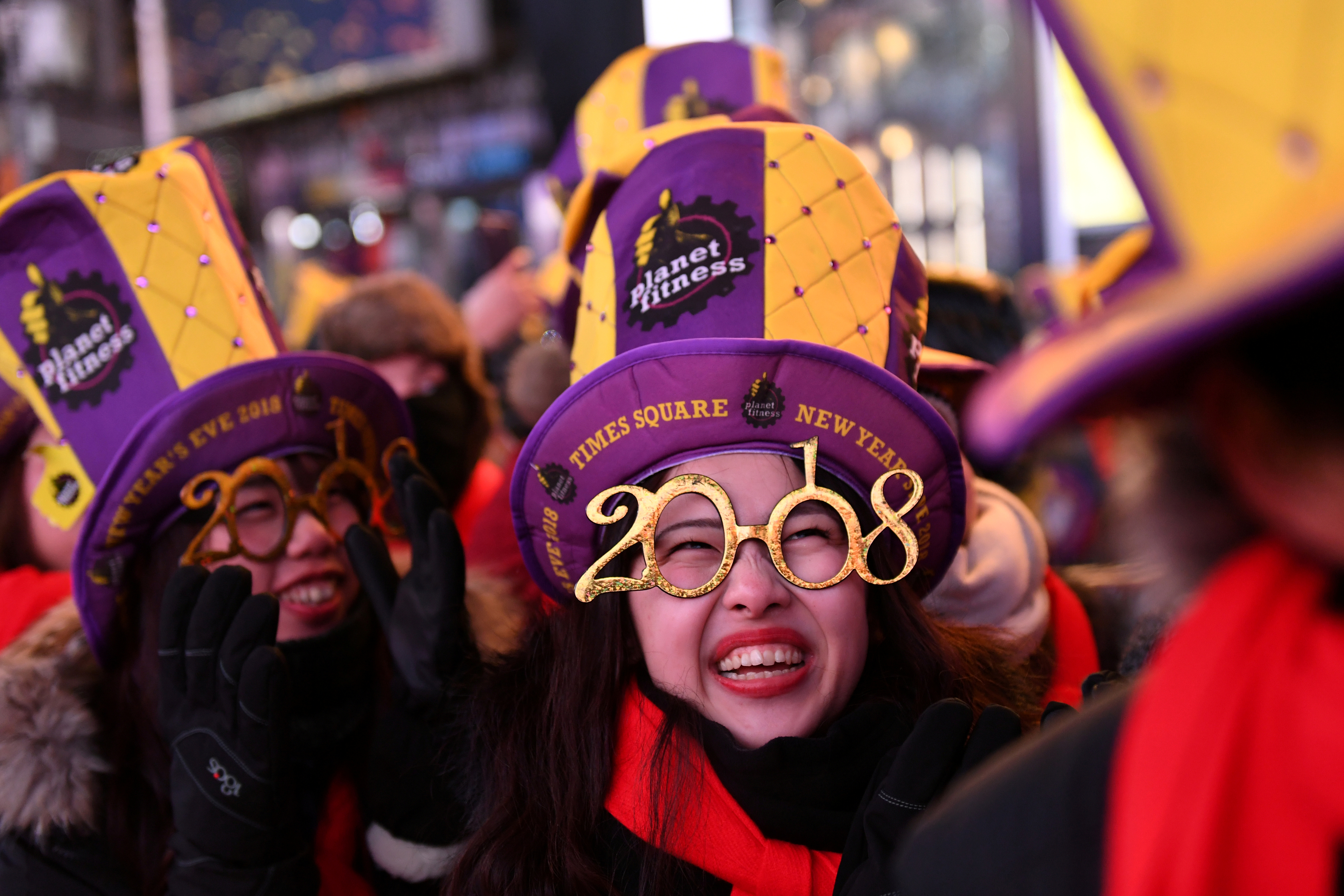 Revelers in Times Square photographed ahead of New Year's celebrations in Manhattan, New York. (Image Credit: Darren Ornitz/Reuters)