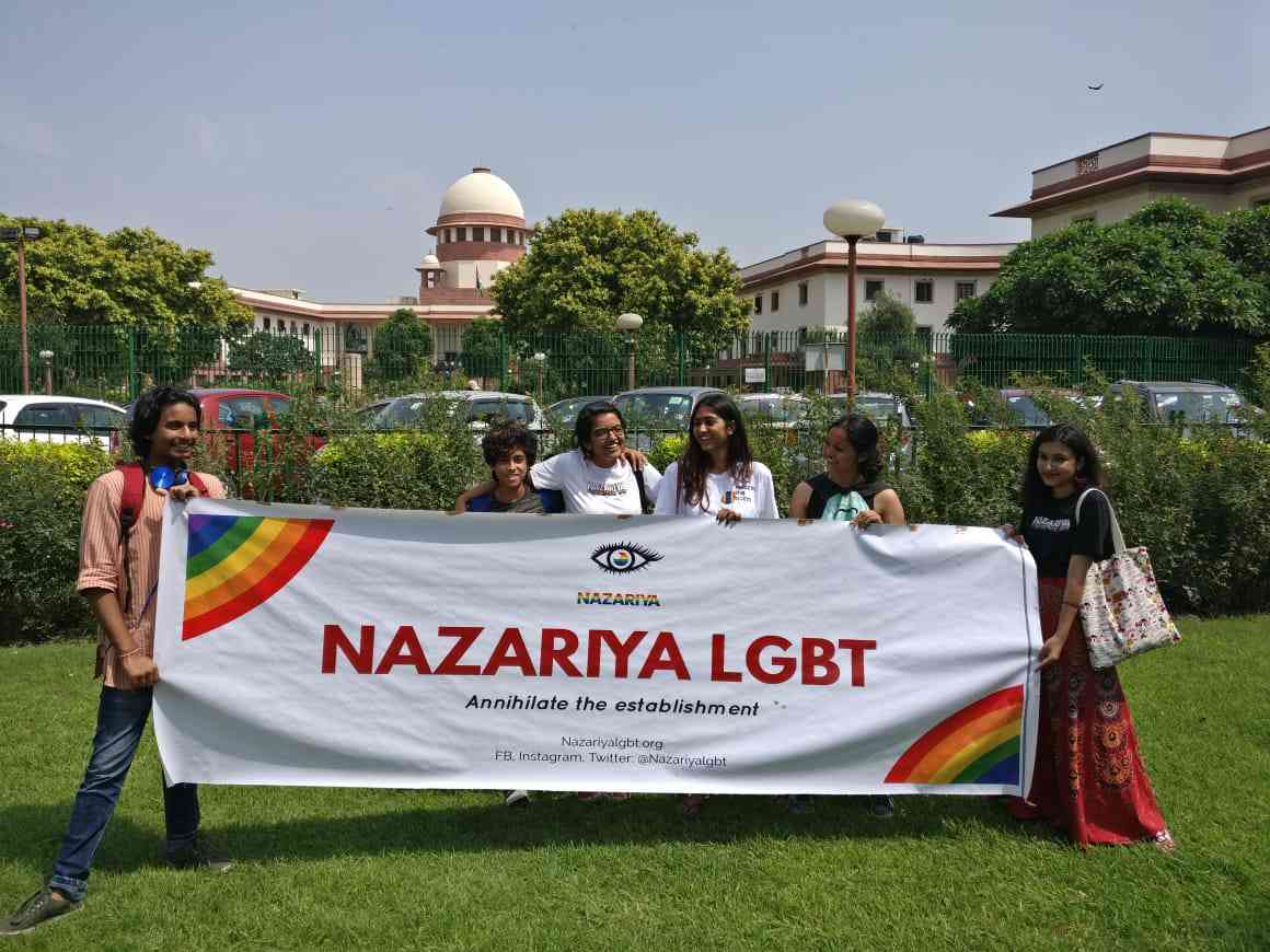 Activists wait outside the Supreme Court. (Credit: Aabid Shafi/Scroll staff)