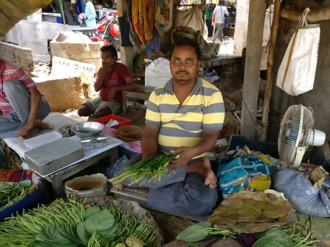 At the nearby Illambazar town market, Abbasuddin said the sale of his betel leaves has dropped sharply.