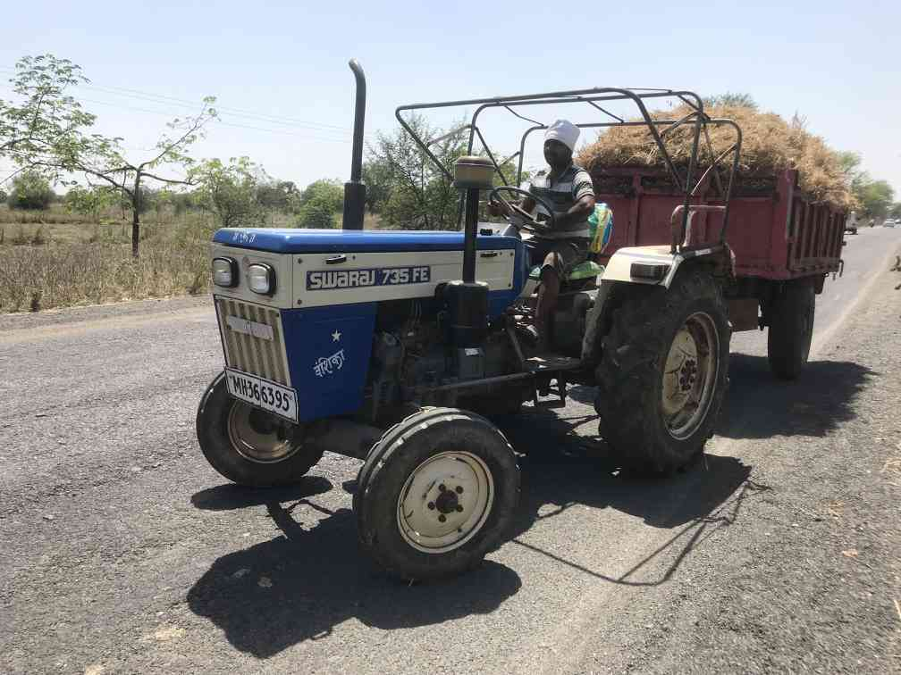 A farmer transports freshly harvested chana crop in his tractor.