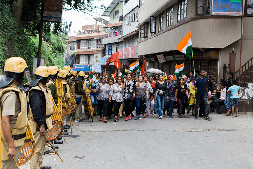 West Bengal Police stand guard during a rally led by women in Kalimpong on June 17. Photo: Praveen Chettri