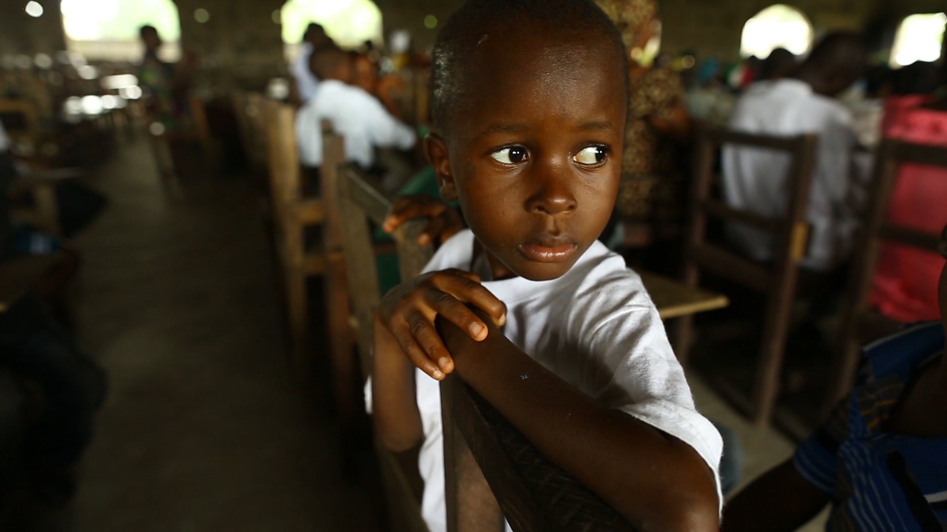 Six-year-old Ebola survivor Patrick Poopei attends Sunday service at his local church in Paynesville, Liberia. (Photo: #ISurvivedEbola/Flickr)