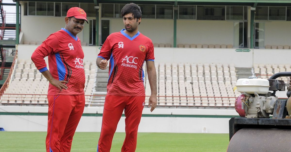 Lalchand Rajput (left) during his stint as coach with the Afghanistan cricket team. Photo: AFP